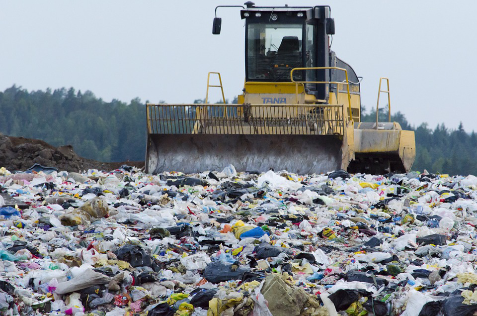 a dumpster in a plastic landfill